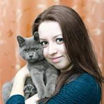 Young woman buys energy healing for her beloved cat